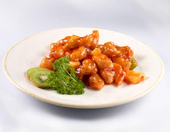 свинина жареная с ананасами и овощами в кисло-сладком соусе из ресторана